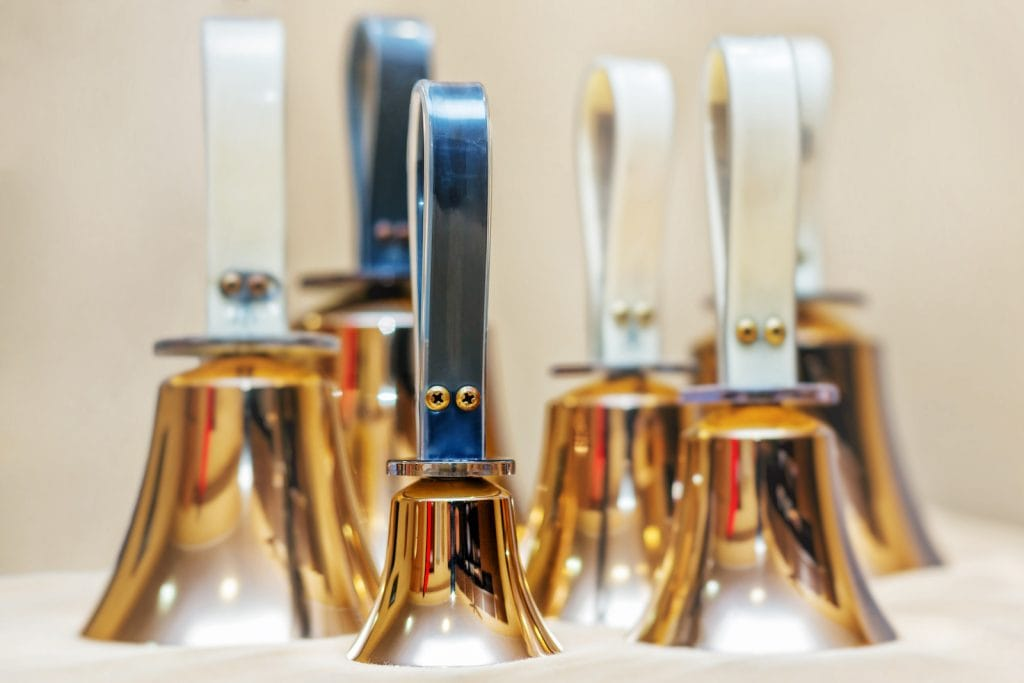 Close up of golden handbells in different sizes ready to play
