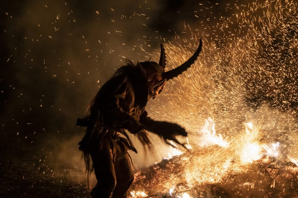 Picture of Krampus standing by a big bonfire