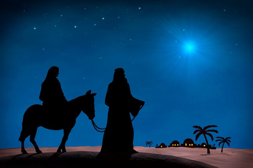 Star in night sky above Mary and Joseph at Christmas