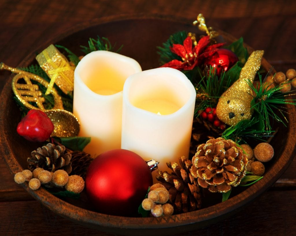 Christmas centerpiece in a small wood bowl, colors in white, green, red and gold
