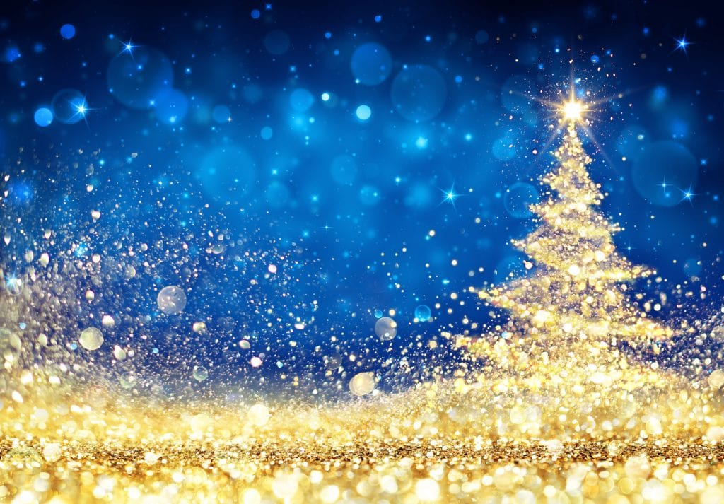 Lights shaped as a Christmas Tree, golden dust glittering on a blue background.