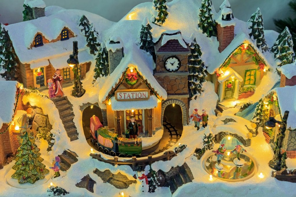 Traditional miniature Christmas village with a train station.