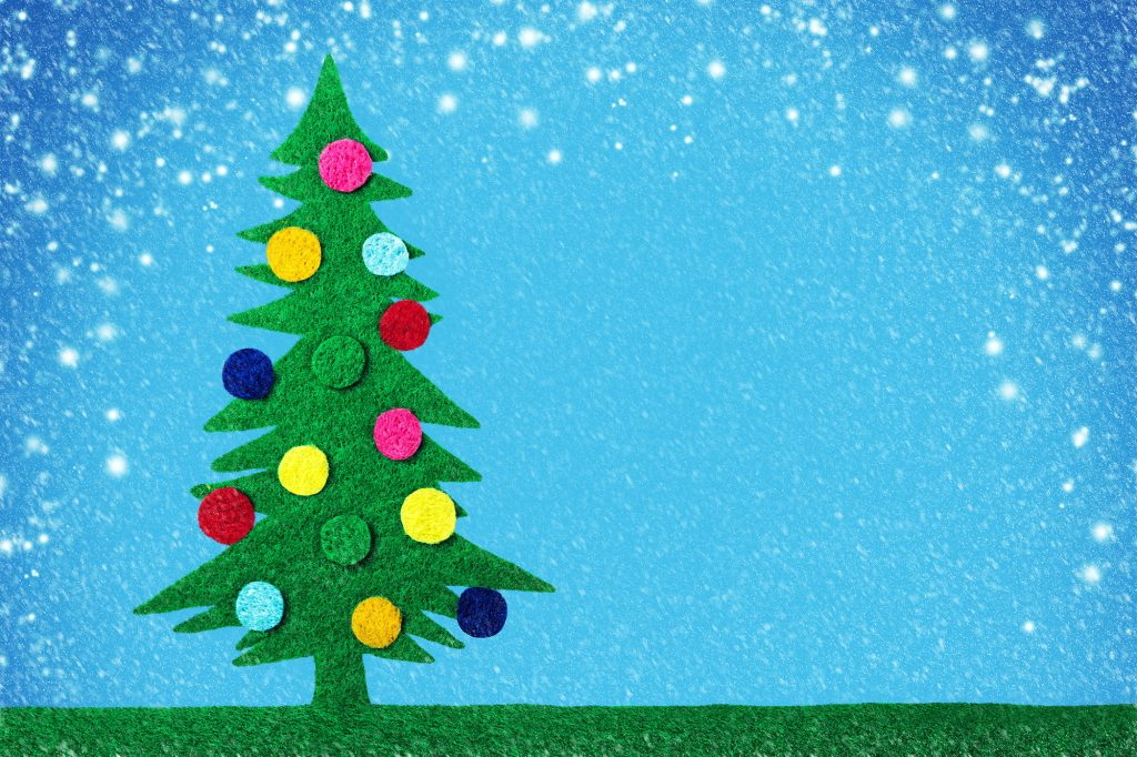 Green felt Christmas tree with colorful bulbs on blue snowy background
