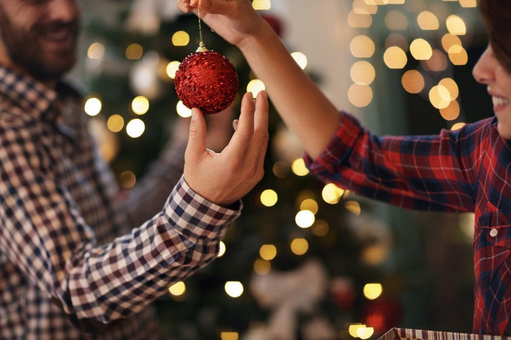 Man and woman decorating for Christmas