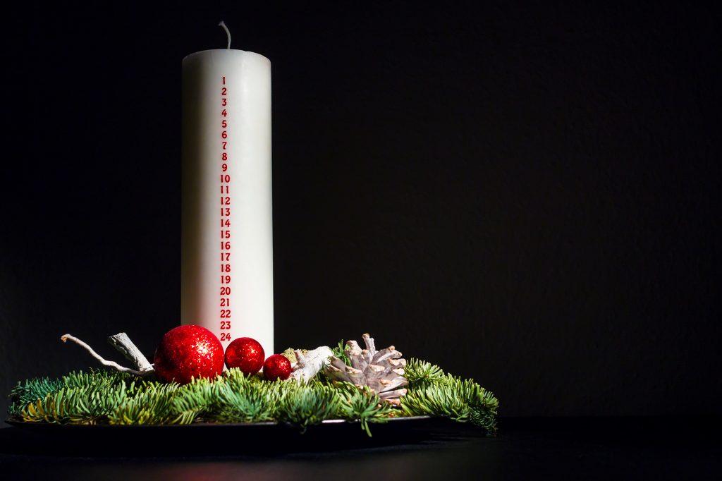 Christmas decoration with unlit Danish calendar candle