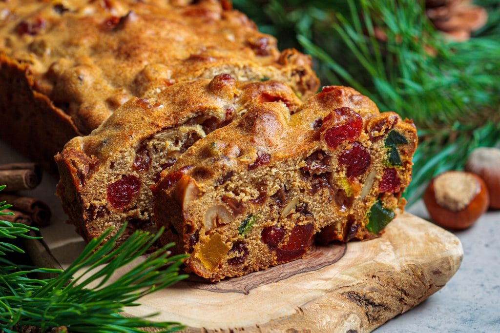 Close up of Christmas fruit cake on a wooden board