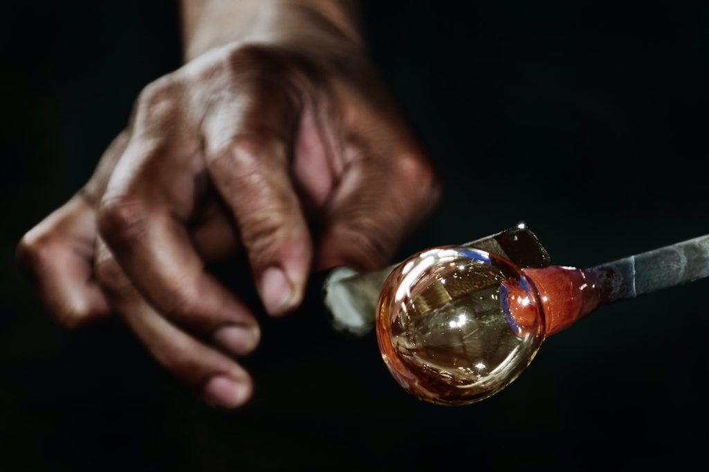 Work of Glass Blower, Glassblower Makes a Sphere.