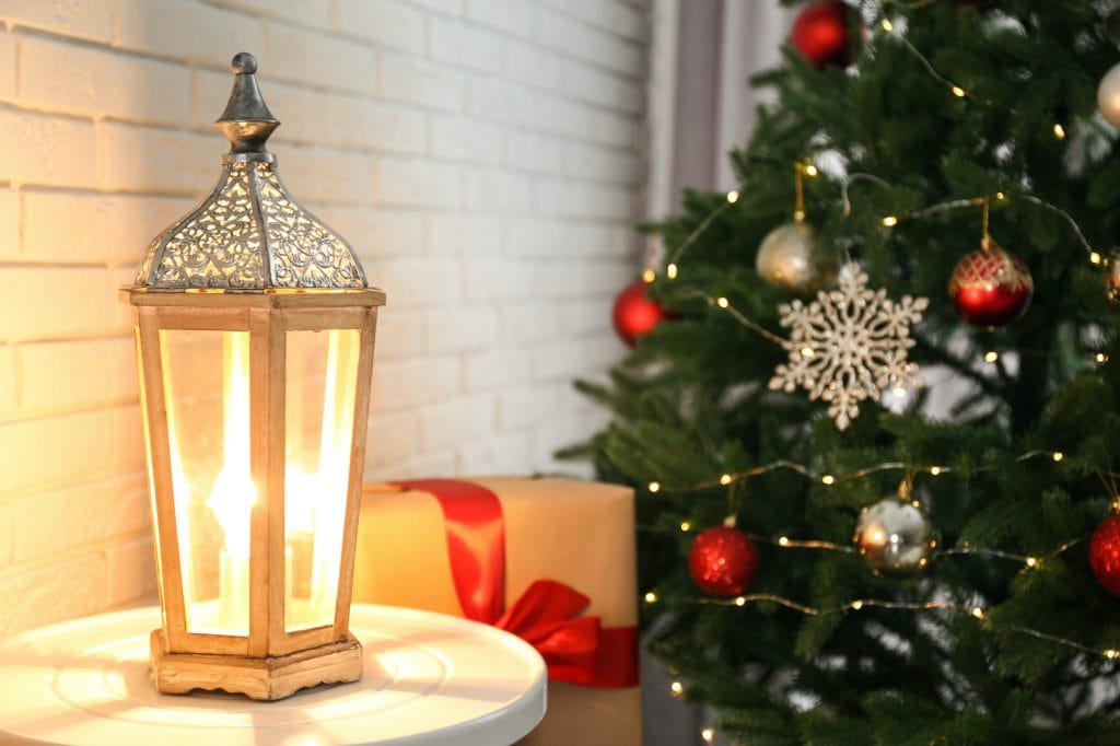Beautiful lantern on table in a room decorated for Christmas.
