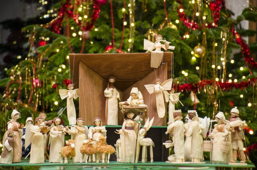 Christmas nativity scene with blurred Christmas tree in the background