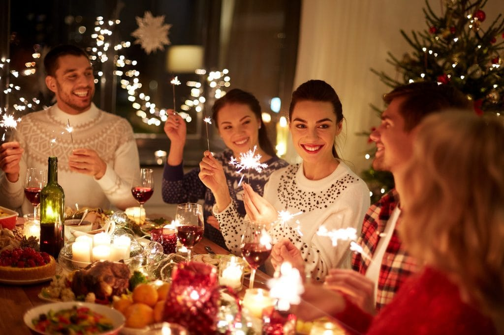 Happy people celebrating Christmas having dinner at home