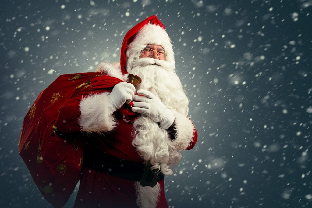 Santa Claus holding a bag with presents