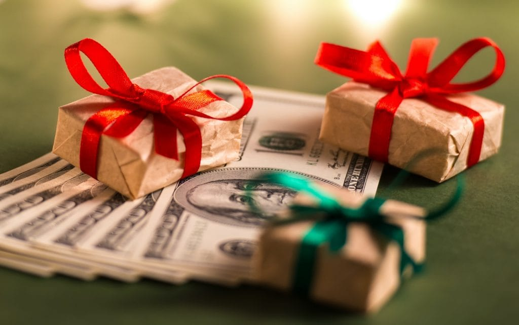 Wrapped gift boxes and US dollar bills