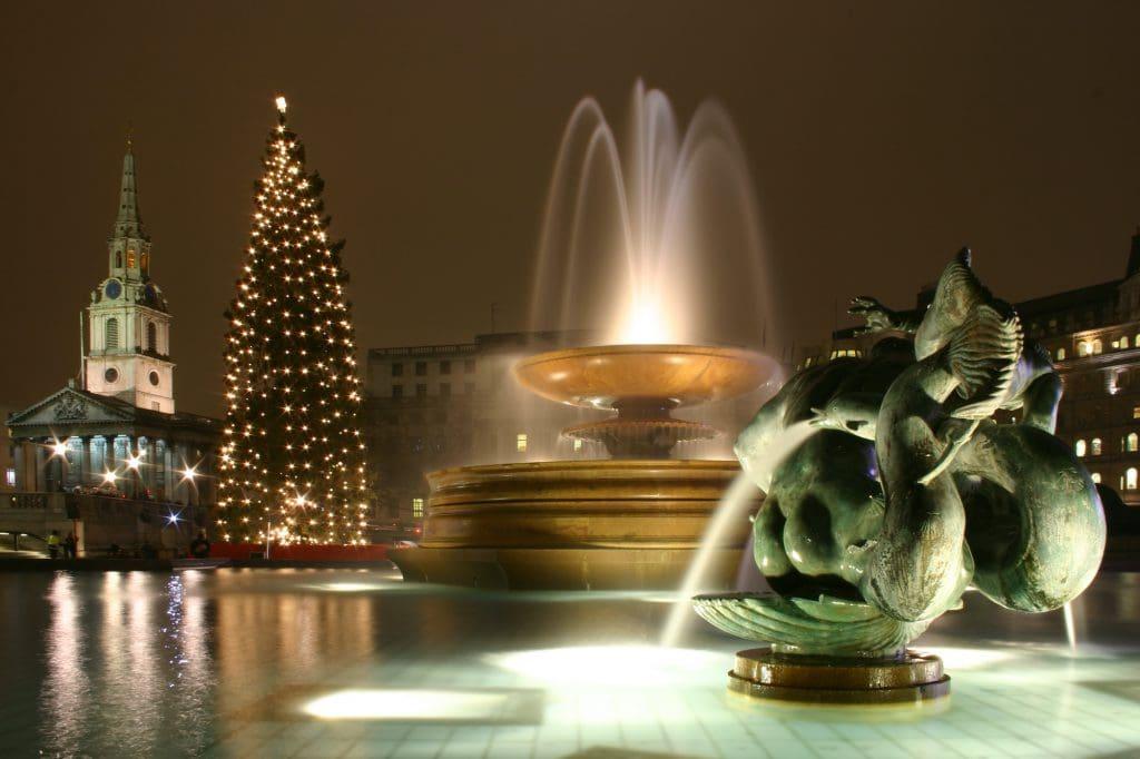 Trafalgar Square London at Christmas with a giant Christmas tree.