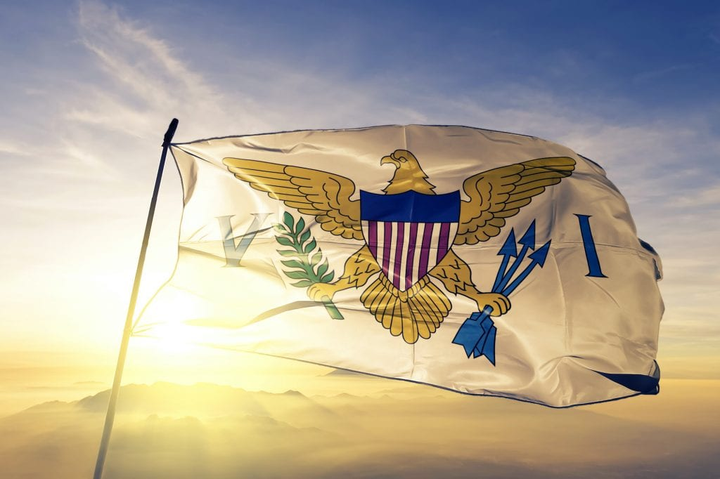 United States Virgin Islands flag blowing in the wind with the sun and blue sky in the background